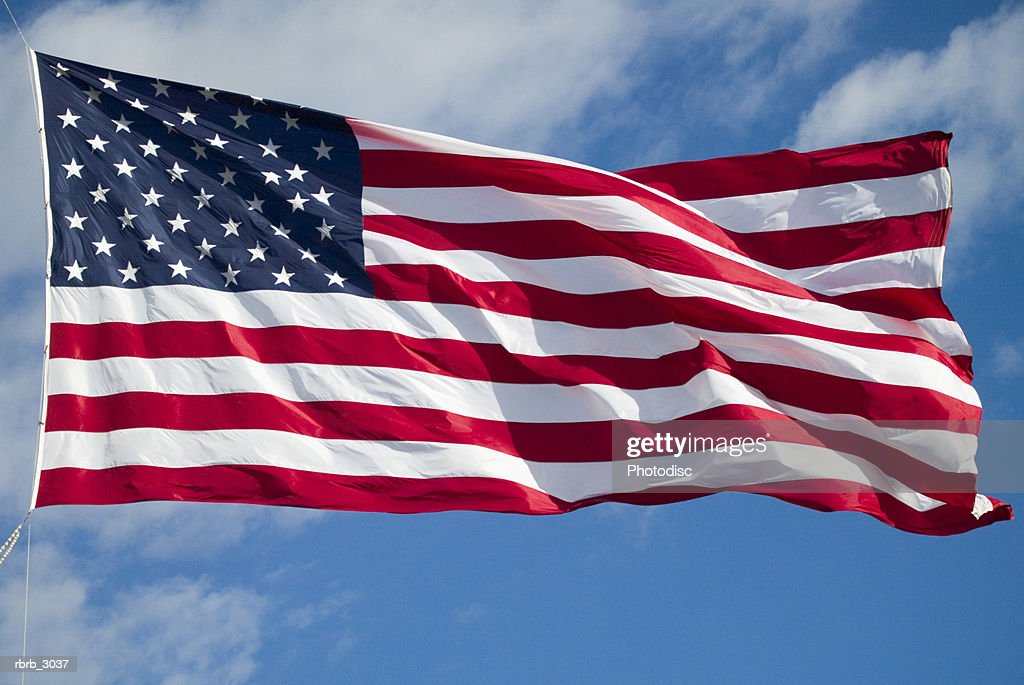 Close-up of the American Flag fluttering : Foto de stock