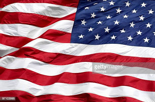 close-up of the american flag waving used for background - american flag background stock pictures, royalty-free photos & images