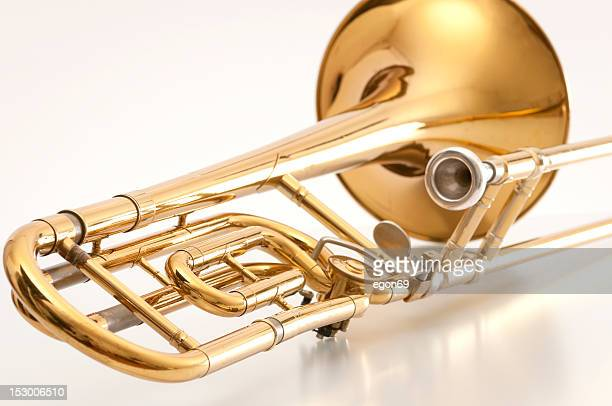 A closeup of the back of a golden trombone