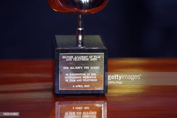 A closeup of the BAFTA that Queen Elizabeth II received in recognition foe a lifetime's support of British Film and Television at a reception for the...