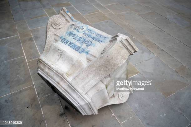 A closeup of the base of the Edward Colston statue on June 8 2020 in Bristol England Yesterday protesters in Bristol toppled the statue of Edward...