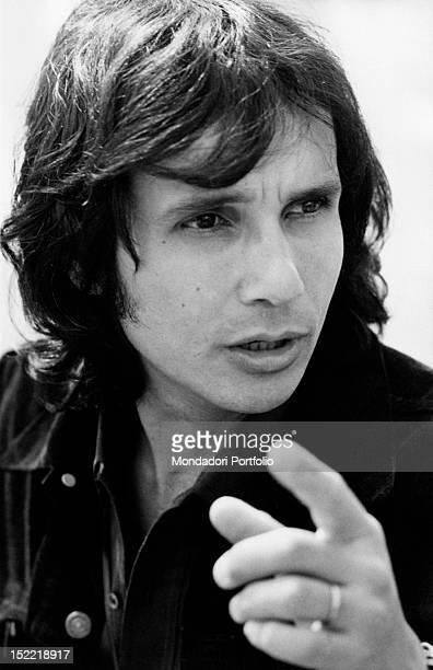 Closeup of the Brasilian singer Roberto Carlos indicating something Milan 1970