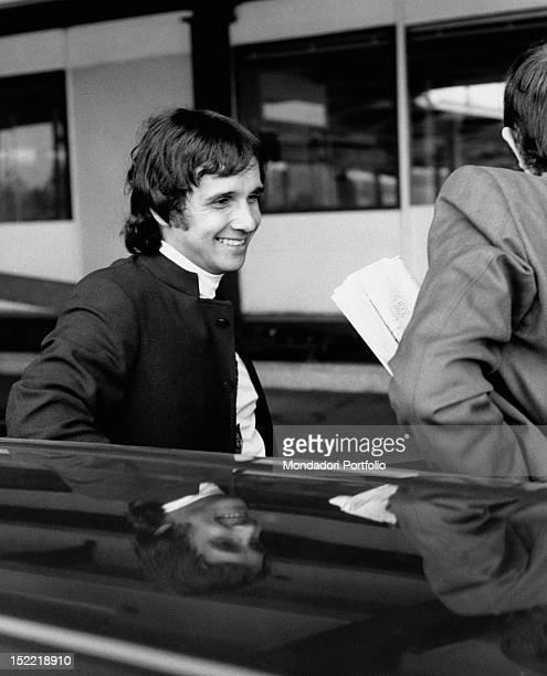 Closeup of the Brasilian singer Roberto Carlos next to a car during a stay in Milan Milan July 1968