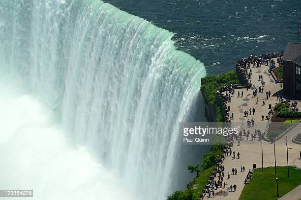 CONTENT] A closeup of the Canadian Horseshoe Falls taken from the outdoor observation platform at the Skylon Tower