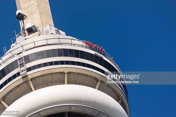 Closeup of the CN tower showing people edgewalking around the edge of the building Edge Walk is Torontos newest and tallest urban adventure and the...