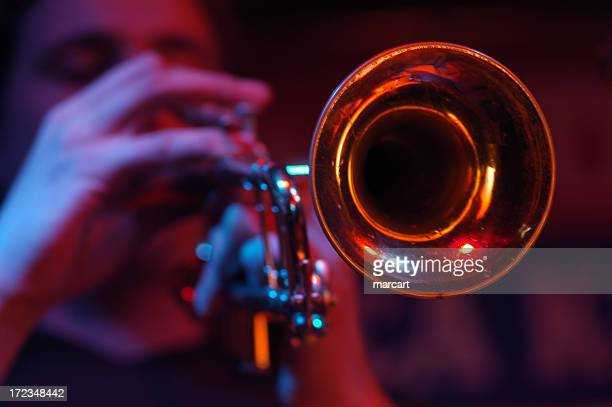 close-up of the cone of a trumpet with player out of focus - jazz music stock pictures, royalty-free photos & images