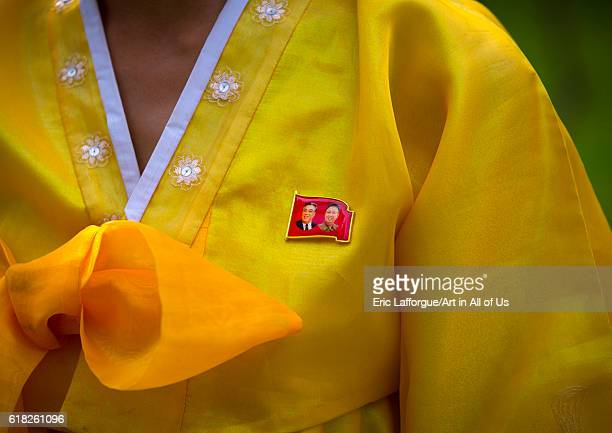 Closeup of the dear leaders badge on the traditional dress of a north korean woman hamhung North Korea on September 11 2012 in Hamhung North Korea
