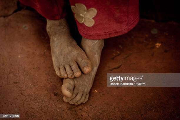 close-up of the feet of a child - dirty feet stock pictures, royalty-free photos & images