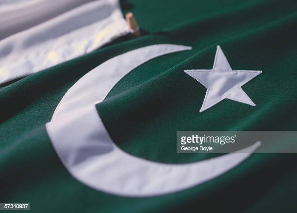 close-up of the flag of pakistan - pakistani flag stock photos and pictures