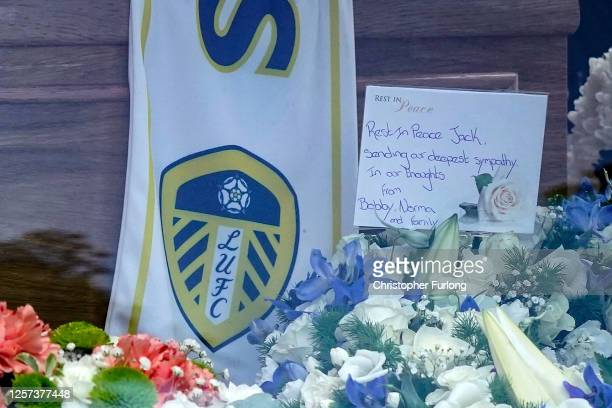 A closeup of the flower tributes for Jack Charlton as his funeral cortege passes through his childhood home town on July 21 2020 in Ashington...
