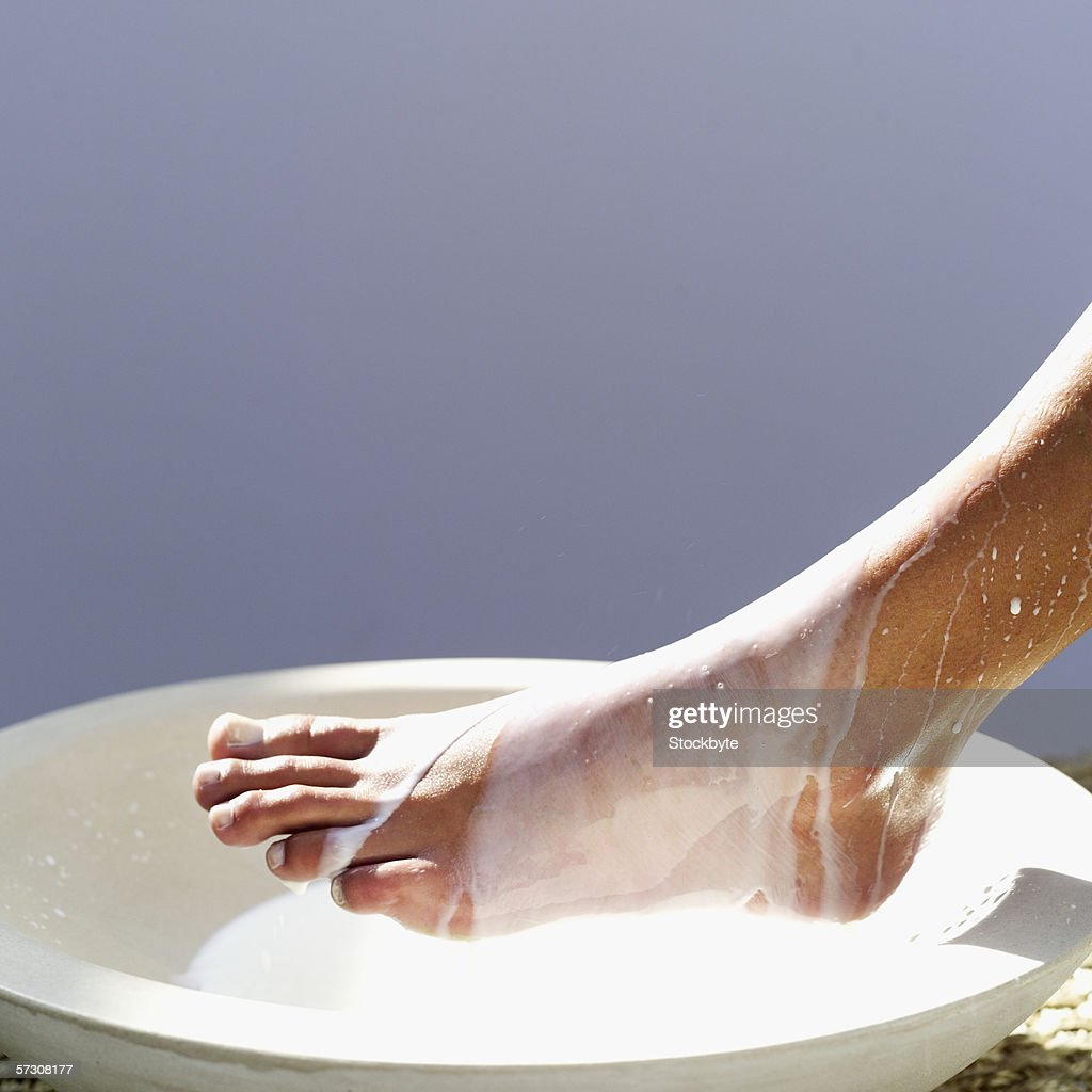 Close-up of the foot of a young woman getting a pedicure : Stock Photo