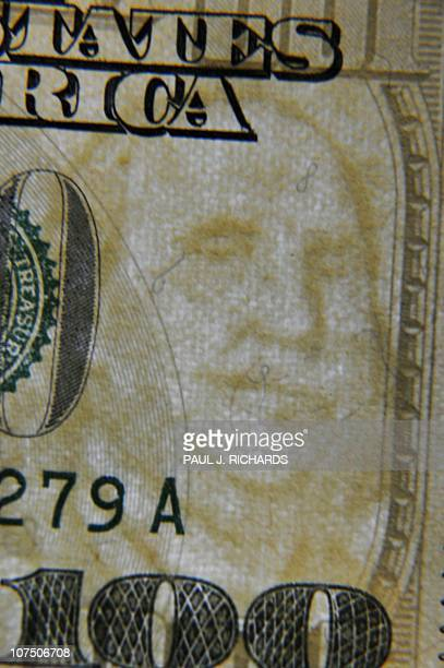 A closeup of the front of the United States 100dollar bill bearing the faint watermark portrait of US statesman inventor and diplomat Benjamin...