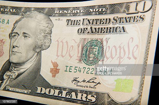 A closeup of the front of the US 10dollar bill bearing the portrait of Alexander Hamilton America's first Treasury Secretary is seen on December 7...