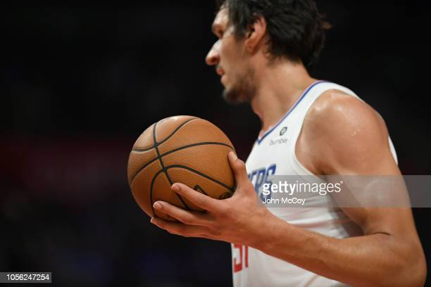 Closeup of the hands of Boban Marjanovic of the Los Angeles Clippers holding a ball during a time out with the Denver Nuggets during the season...