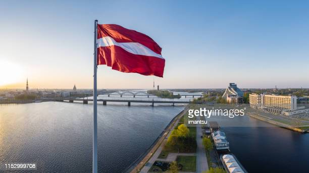 closeup of the huge flag of latvia haning above the ab dam in riga - latvia stock pictures, royalty-free photos & images