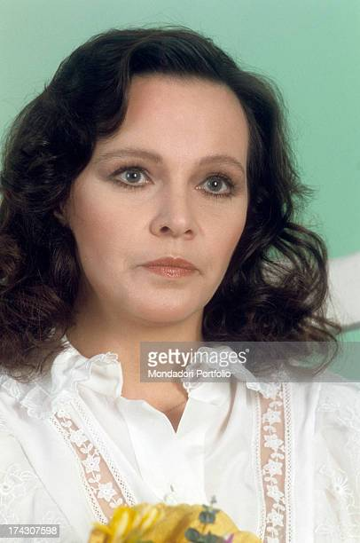 Closeup of the Italian actress Laura Antonaz known as Laura Antonelli looking up with serious glance the actress is wearing a white blouse with lace...