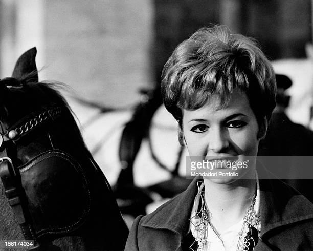 Closeup of the Italian singer actress presenter showgirl and impersonator Loretta Goggi smiling next to a horse last year Loretta Goggi reached...