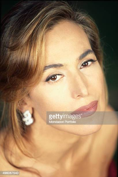 Closeup of the Italian TV presenter and actress Barbara D'Urso posing during a photo shoot Italy 1998