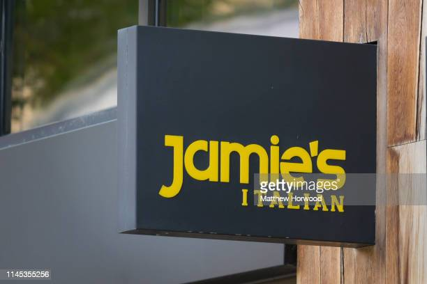 A closeup of the Jamies Italian restaurant sign on May 21 2019 in Cardiff United Kingdom More than 1000 jobs are at risk after the chain of...