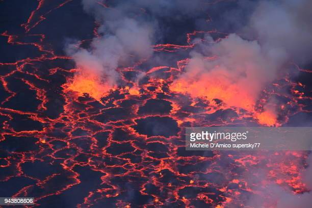 closeup of the lava lake inside the crater of nyiragongo - smoking crack stock photos and pictures