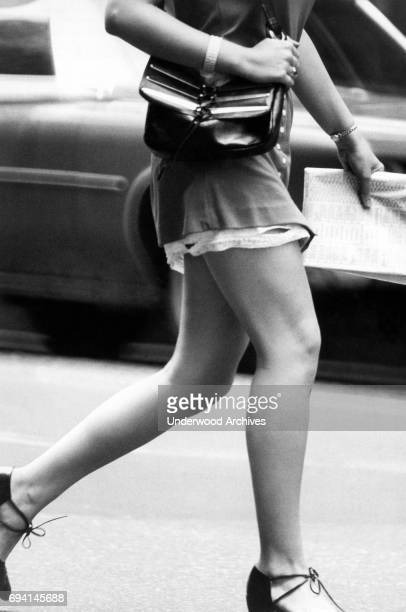 Closeup of the legs of an unidentified woman in a minidress as she walks near Central Park New York New York August 1971