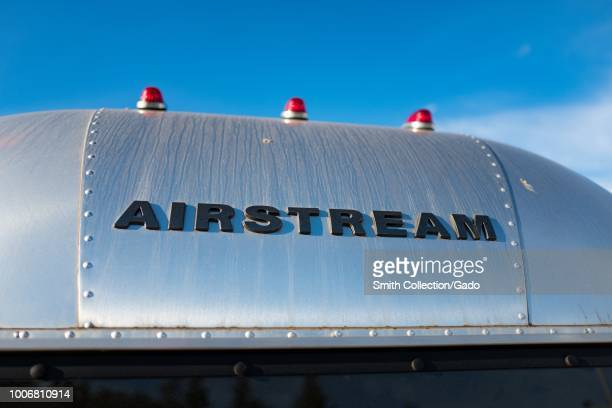 Closeup of the logo on the back of a classic aluminum Airstream camping trailer against a blue sky in Pleasanton California July 23 2018