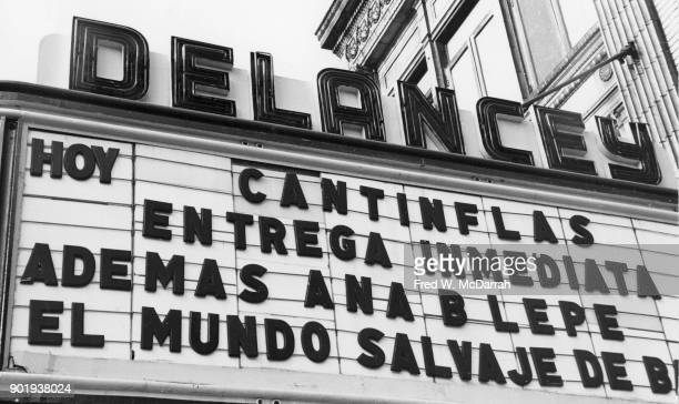 Closeup of the marquee of the New Delancey Theater cinema New York New York December 2 1963 It advertises 'Entrega Immediata' and 'El Mundo Salvaje...