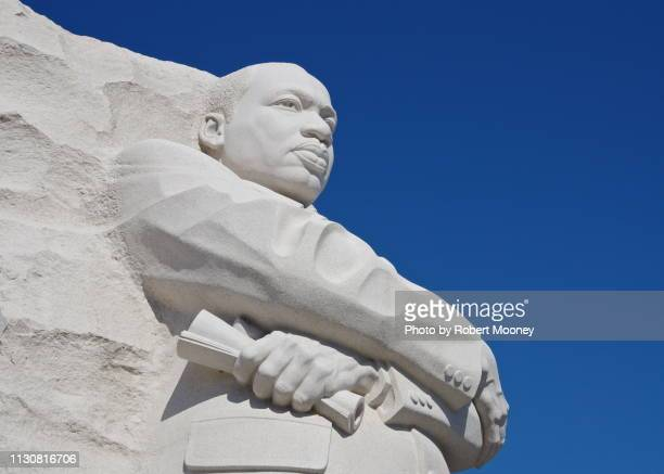 close-up of the martin luther king, jr. memorial against a blue sky (washington dc) - martin luther king jr. memorial washington dc stock pictures, royalty-free photos & images