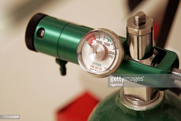 A close-up of the meter of a green oxygen tank