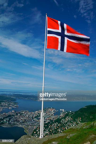 close-up of the norwegian flag flying, bergen, norway - norwegian flag stock pictures, royalty-free photos & images