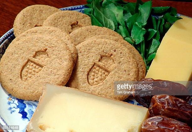 Closeup Of The Oaten Biscuits 'duchy Originals' On A Plate With Some Cheese The Biscuits Have The Duchy Of Cornwall Coat Of Arms Surmounted By The...