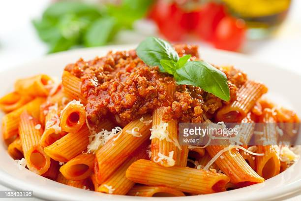 Close-up of the orange-toned penne Bolognese