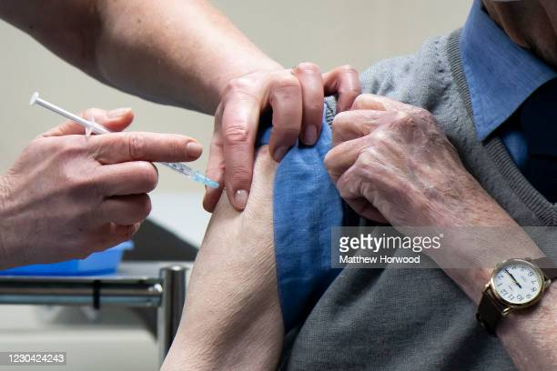 Close-up of the Oxford-AstraZeneca vaccine being administered into a patients arm at Pontcae Medical Practice on January 4, 2021 in Merthyr Tydfil,...