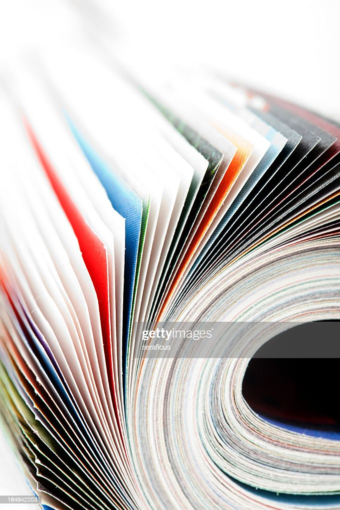 Close-up of the pages of a magazine being flipped : Stock Photo