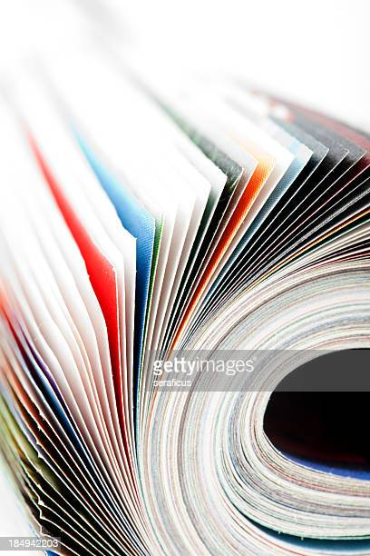 close-up of the pages of a magazine being flipped - magazine page stock photos and pictures