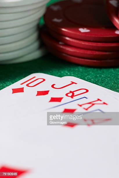 Close-up of the poker of diamonds with stacks of gambling chips on a gambling table