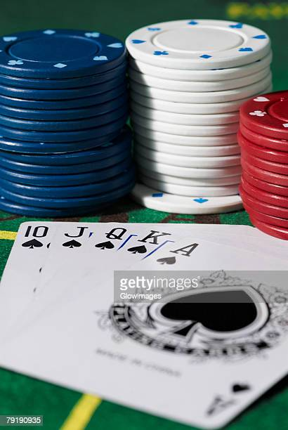 close-up of the poker of spades with gambling chips on a gambling table - royal flush stock photos and pictures