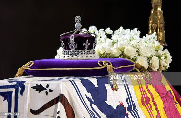 A closeup of the Queen Mother's coffin the wreath of white flowers and the Queen Mother's coronation crown with the priceless KohINoor diamond