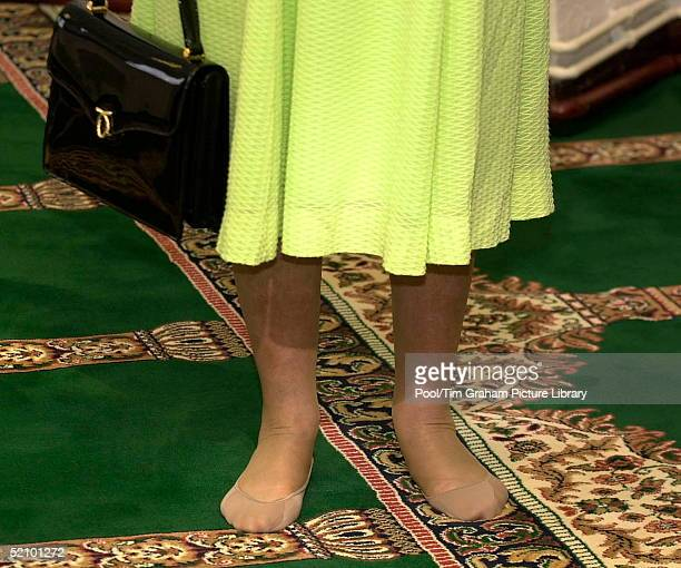 Closeup Of The Queen's Feet She Is Wearing Sockettes Over Her Stockings In Accordance With Islamic Tradition Which Demands That You Remove Your Shoes...