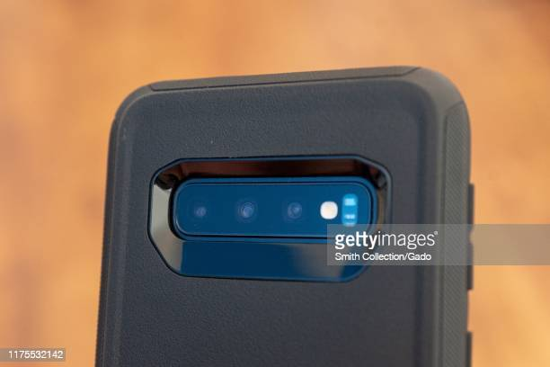 Closeup of the rear of a Samsung Galaxy S10 smart phone showing multiple cameras including a wide angle camera closeup camera and standard camera...