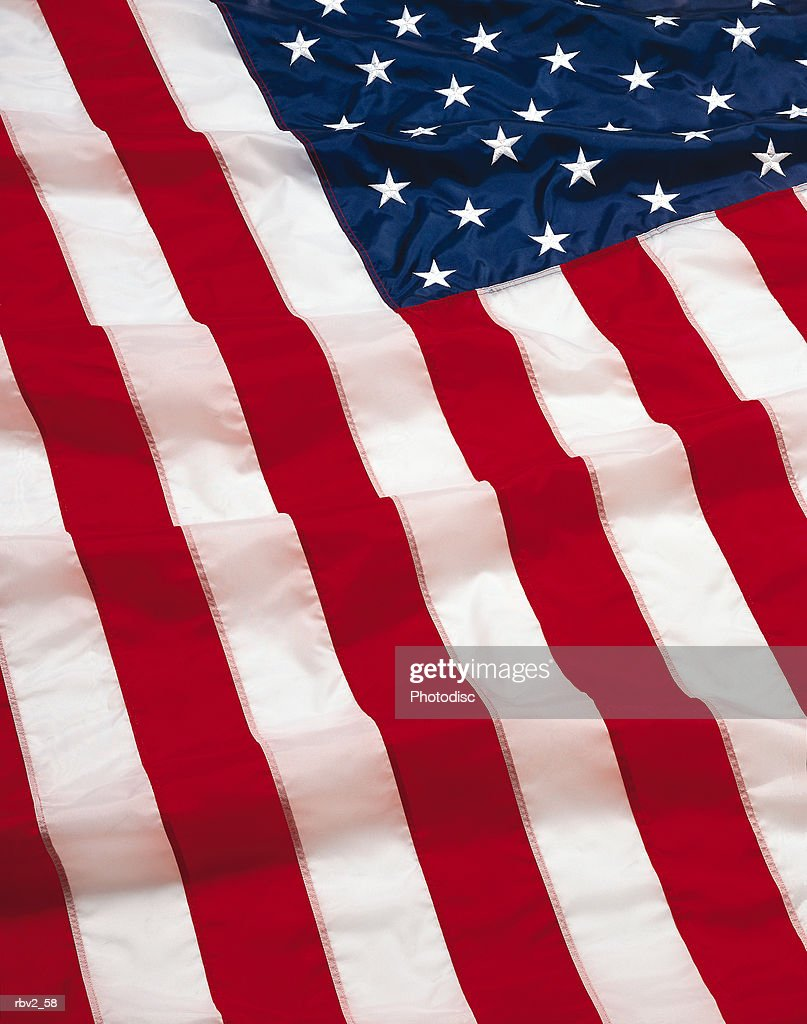 A close-up of the red and white and blue of the American Flag : Foto de stock