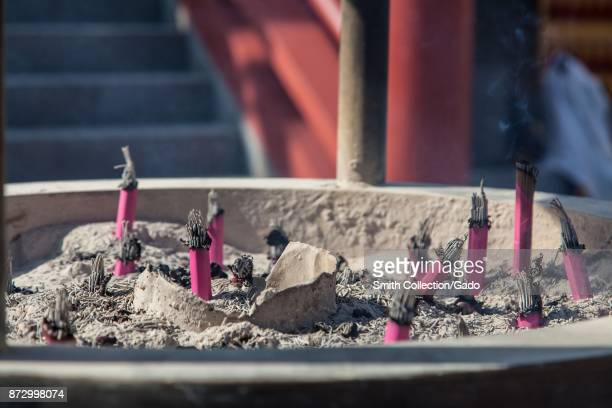 Closeup of the remains of burnt offerings at the Bentendo Temple in Ueno Park Ueno District Taito Tokyo Japan November 2017