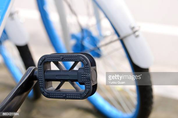 close-up of the shared bike's pedal.china's bike sharing boom in charts. - bicycle parking station stock photos and pictures