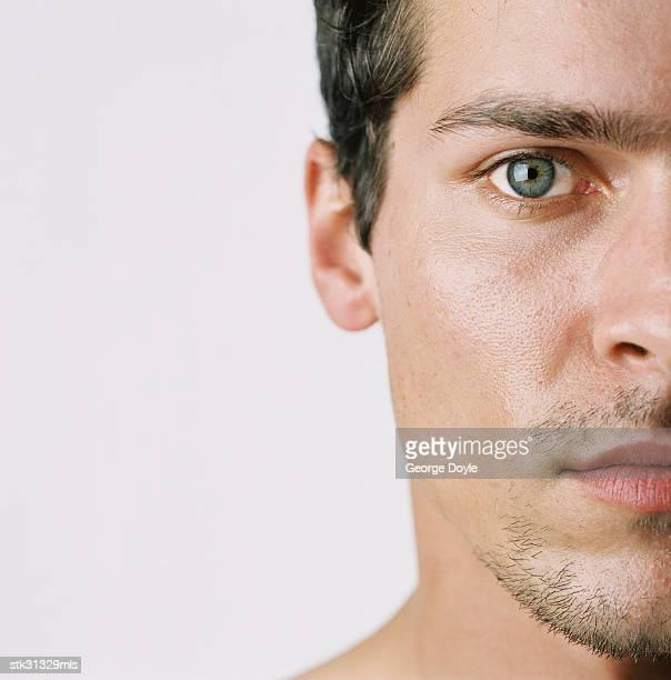 close-up of the side of a man's face - blaue augen stock-fotos und bilder