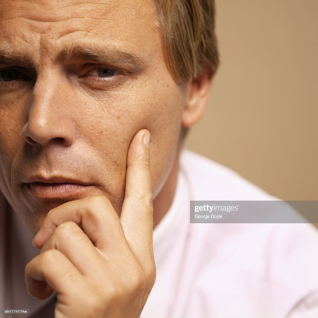 Close-up of the side of a young businessman's face : Stock Photo