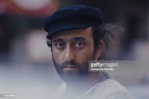 Closeup of the singer Lucio Dalla wearing a blue flat cap Italy 1976