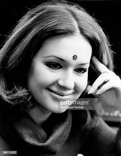 Closeup of the smiling Italian singer actress presenter show girl and impersonator Loretta Goggi on her forehead a bindi an Asian decoration in 1968...