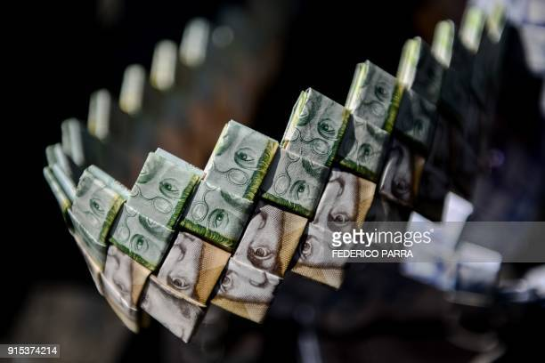 TOPSHOT Closeup of the strap of a purse made by Venezuelan Wilmer Rojas out of Bolivar banknotes in Caracas on January 30 2018 A young Venezuelan...