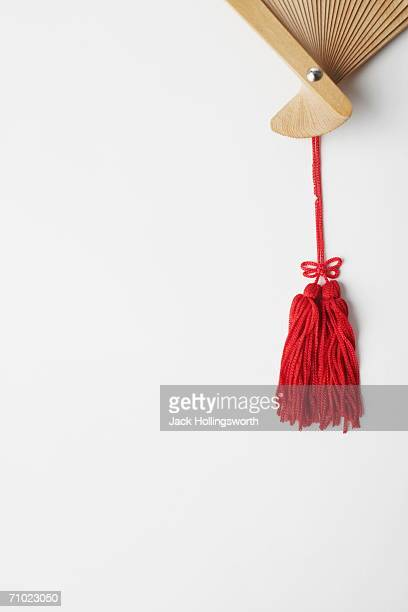 close-up of the tassel of a folding fan - tassel stock pictures, royalty-free photos & images