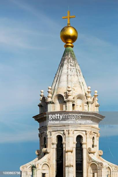 close-up of the top of florence cathedral dome, with lantern, gold globe, and cross against a blue sky - blue balls pics stock pictures, royalty-free photos & images